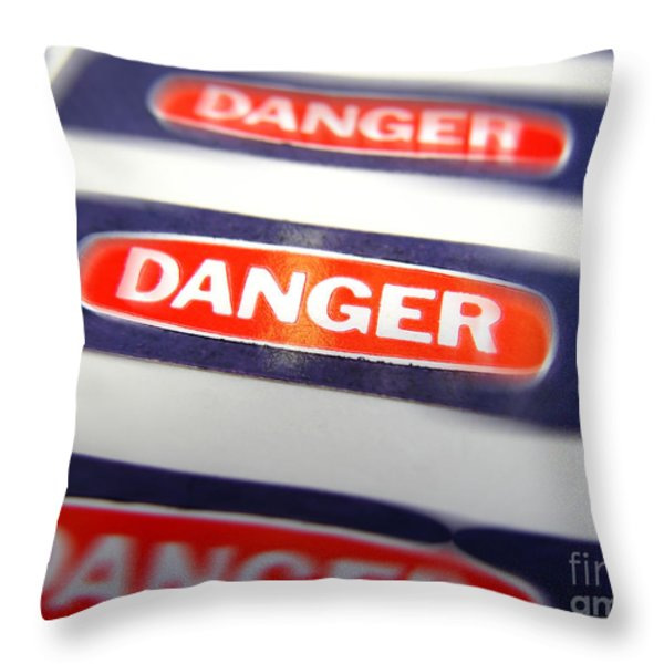 Danger Throw Pillow by Olivier Le Queinec