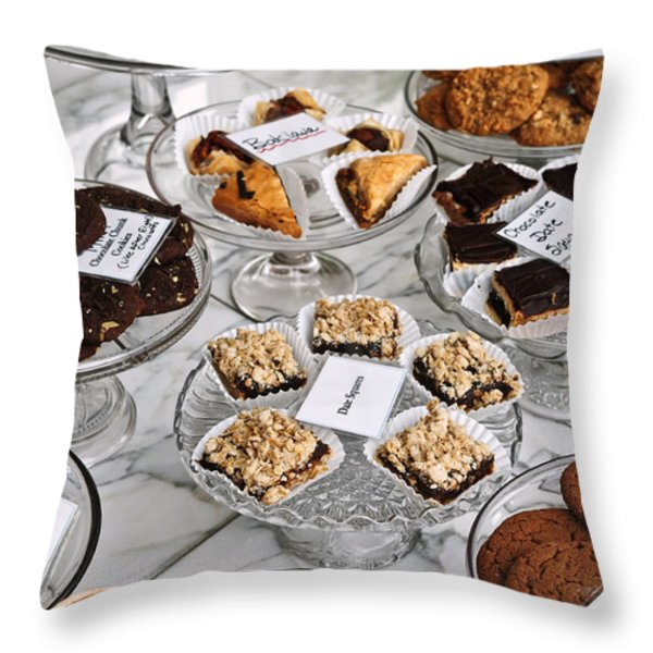 Desserts In Bakery Window Throw Pillow by Elena Elisseeva