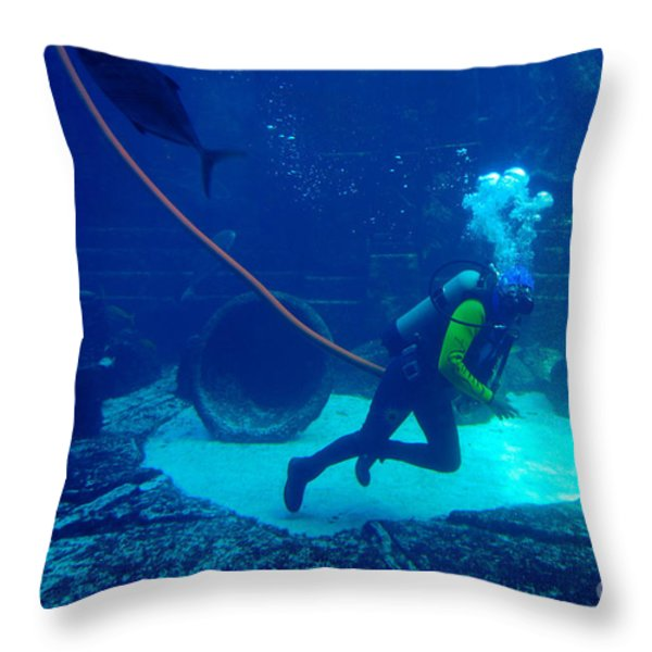 Diver At The Dig Aquarium Atlantis Resort Throw Pillow by Amy Cicconi