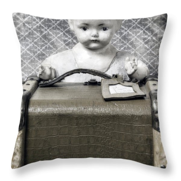 Doll In Suitcase Throw Pillow by Joana Kruse