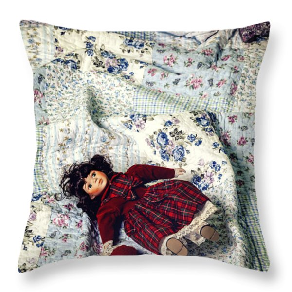 doll on bed Throw Pillow by Joana Kruse
