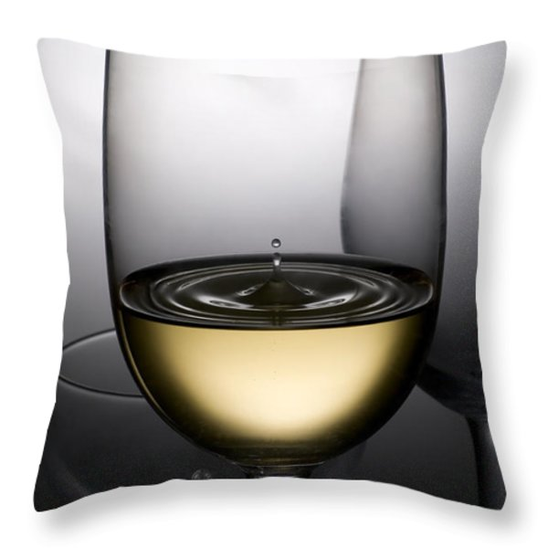 drops of wine in wine glasses Throw Pillow by Setsiri Silapasuwanchai