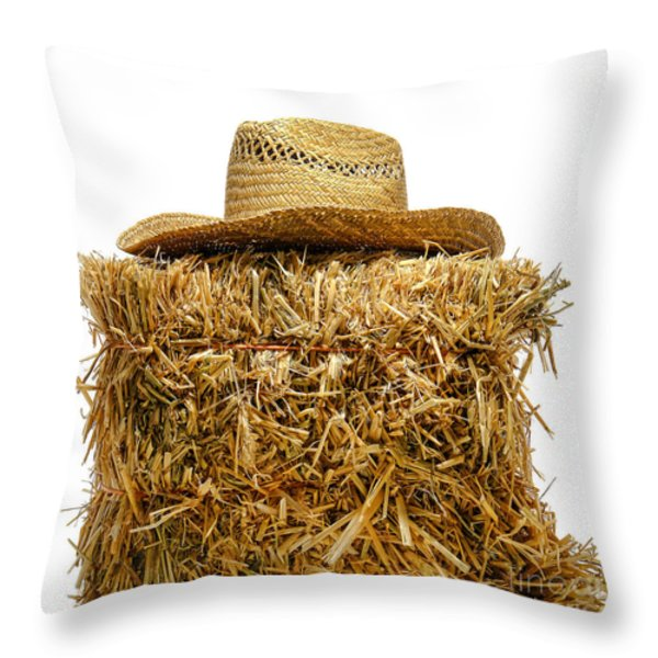Farmer Hat On Hay Bale Throw Pillow by Olivier Le Queinec