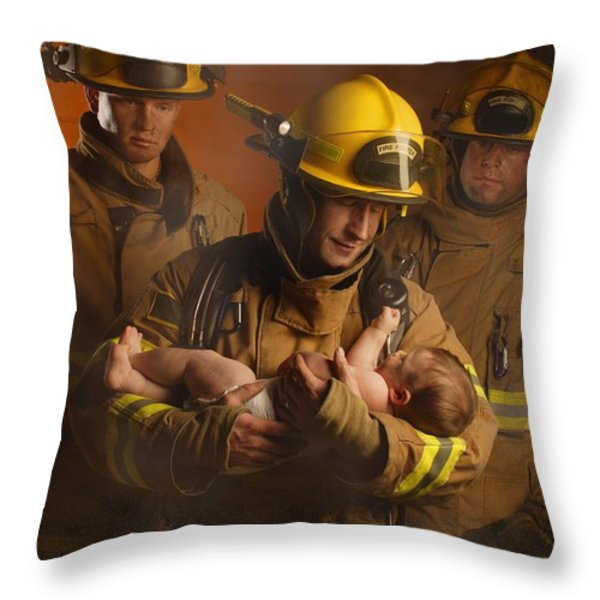 Fire Fighters Rescuing A Baby Throw Pillow by Don Hammond