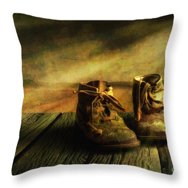 First Shoes Throw Pillow by Veikko Suikkanen