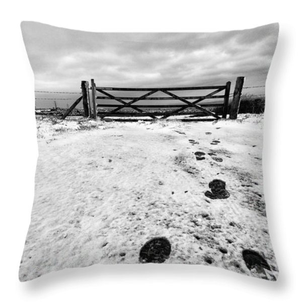 Footprints in the snow Throw Pillow by John Farnan