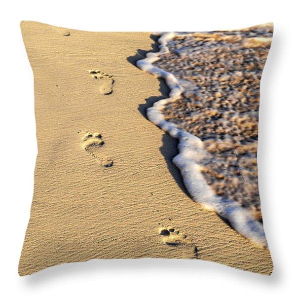 Footprints on beach Throw Pillow by Elena Elisseeva