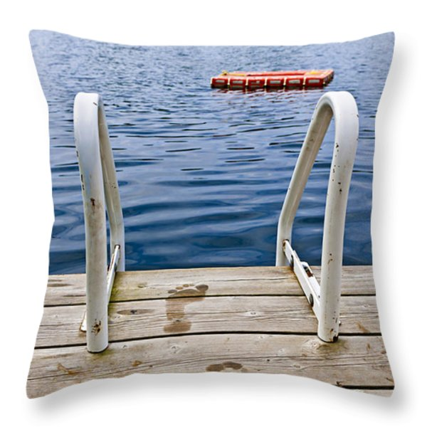 Footprints on dock at summer lake Throw Pillow by Elena Elisseeva
