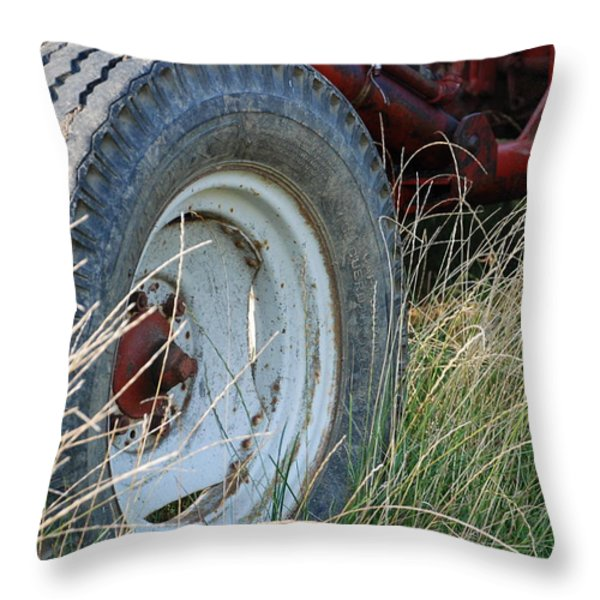 Ford Tractor Tire Throw Pillow by Jennifer Lyon