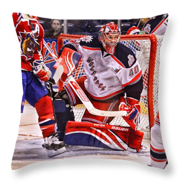 Goaltending Throw Pillow by Karol  Livote