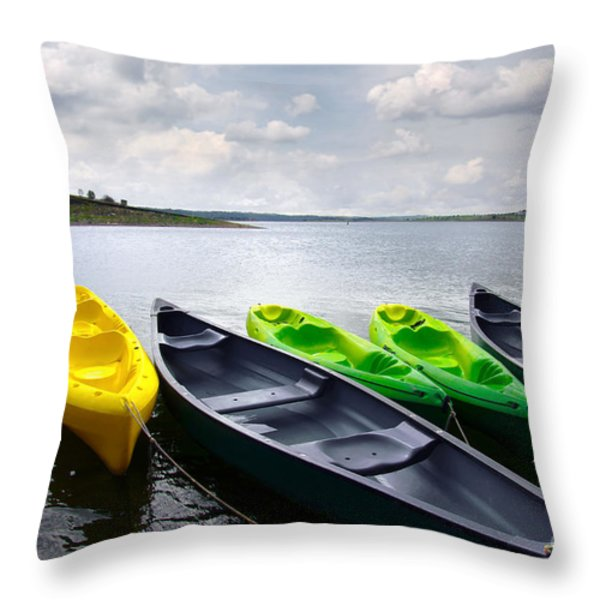 Green and yellow kayaks Throw Pillow by Carlos Caetano