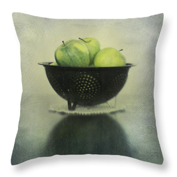Green apples in an old enamel colander Throw Pillow by Priska Wettstein