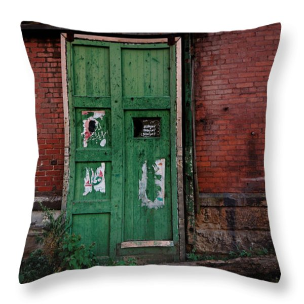 Green Door On Red Brick Wall Throw Pillow by Amy Cicconi