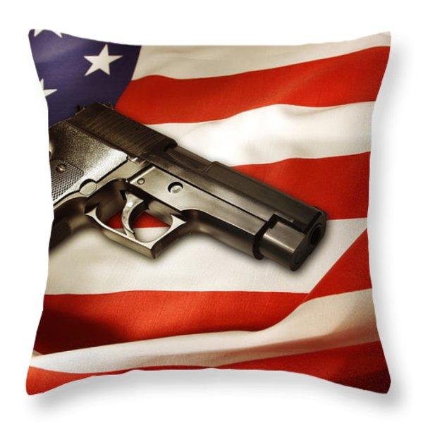 Gun on flag Throw Pillow by Les Cunliffe