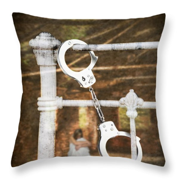 Handcuffs On Bed Throw Pillow by Amanda And Christopher Elwell