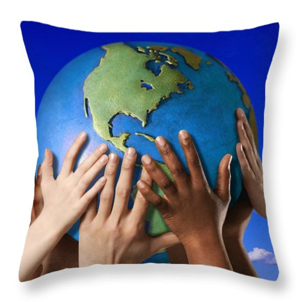 Hands On A Globe Throw Pillow by Don Hammond