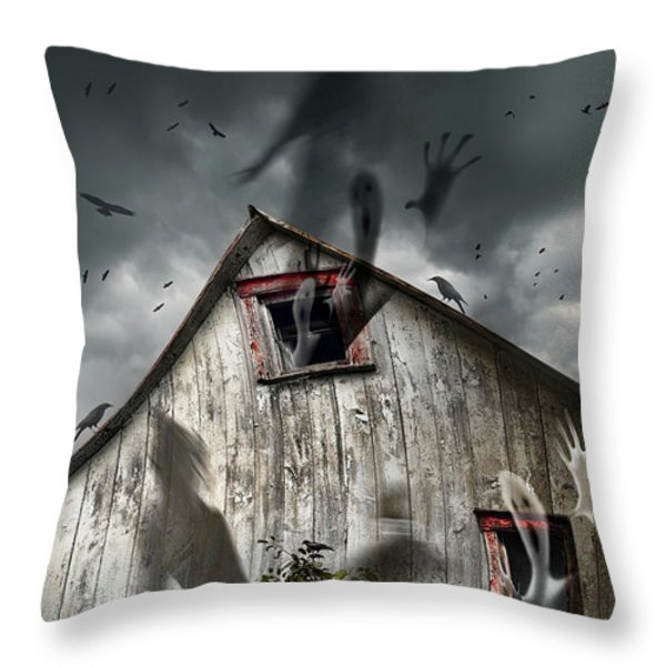 Haunted barn with ghosts flying and dark skies Throw Pillow by Sandra Cunningham