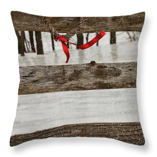 Heart-shape wreath with red ribbon on fence Throw Pillow by Sandra Cunningham
