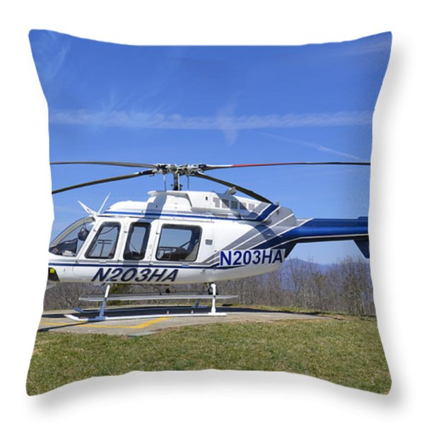 Helicopter On A Mountain Throw Pillow by Susan Leggett