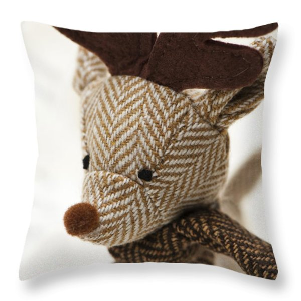 Herringbone Reindeer Throw Pillow by Anne Gilbert
