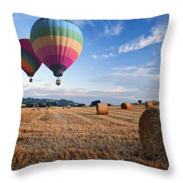 Hot air balloons over hay bales sunset landscape Throw Pillow by Matthew Gibson