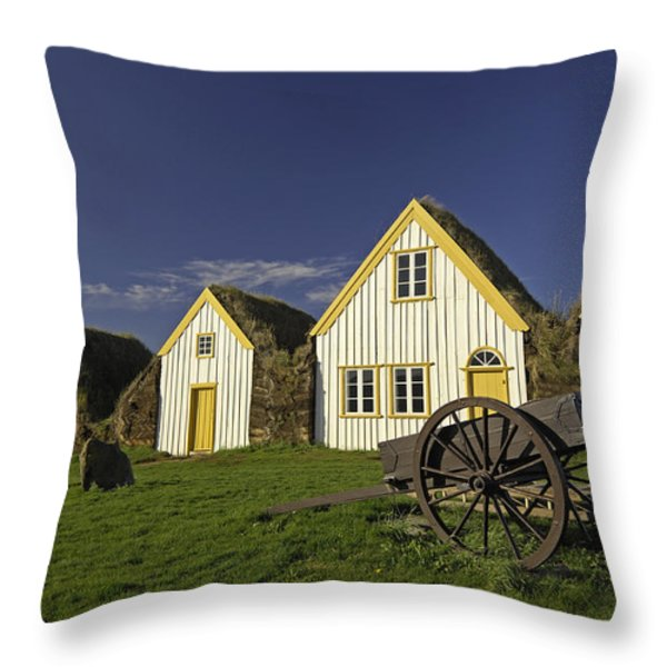 Icelandic Turf Houses Throw Pillow by Claudio Bacinello