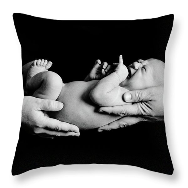 In Your Hands Throw Pillow by Sebastian Musial
