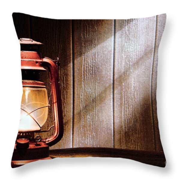 Kerosene Lantern Throw Pillow by Olivier Le Queinec