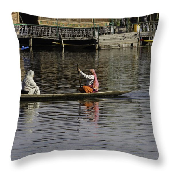 Ladies plying a small boat in the Dal Lake in Srinagar - in fron Throw Pillow by Ashish Agarwal