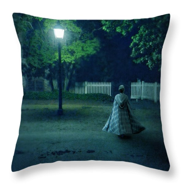 Lady in Vintage Clothing Walking by Lamplight Throw Pillow by Jill Battaglia