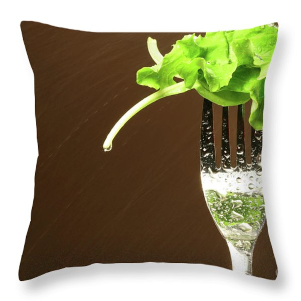 Leaf of lettuce on a fork Throw Pillow by Sandra Cunningham