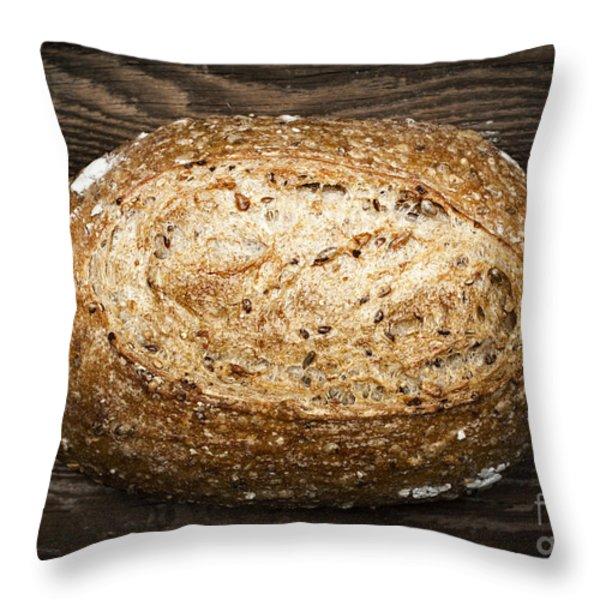 Loaf of multigrain artisan bread Throw Pillow by Elena Elisseeva