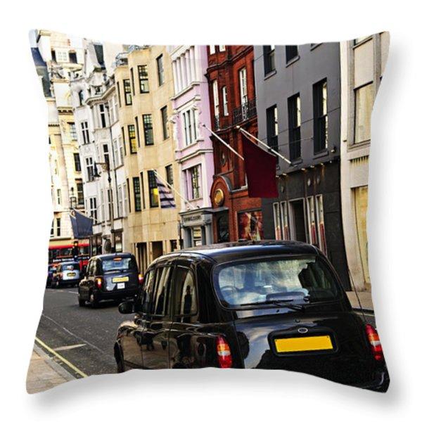 London Taxi On Shopping Street Throw Pillow by Elena Elisseeva
