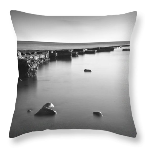 Long Exposure Image Of Tide Going Out Over Rock Ledge During Sun Throw Pillow by Matthew Gibson