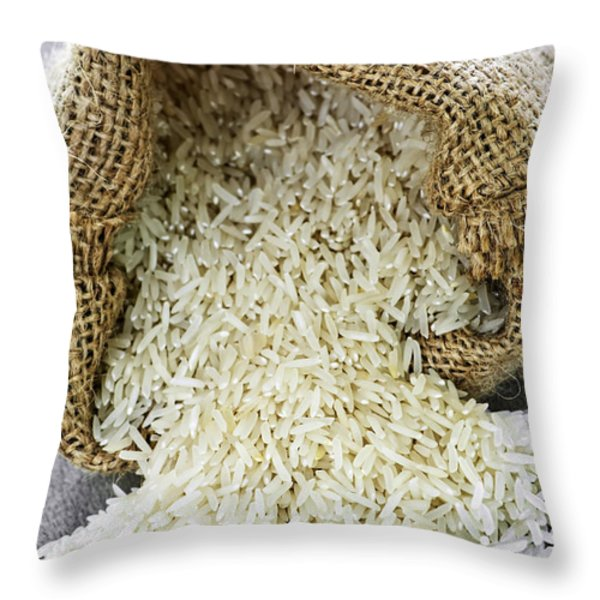 Long grain rice in burlap sack Throw Pillow by Elena Elisseeva