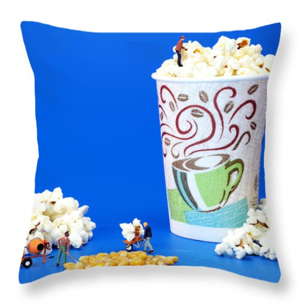 Making popcorn Throw Pillow by Paul Ge