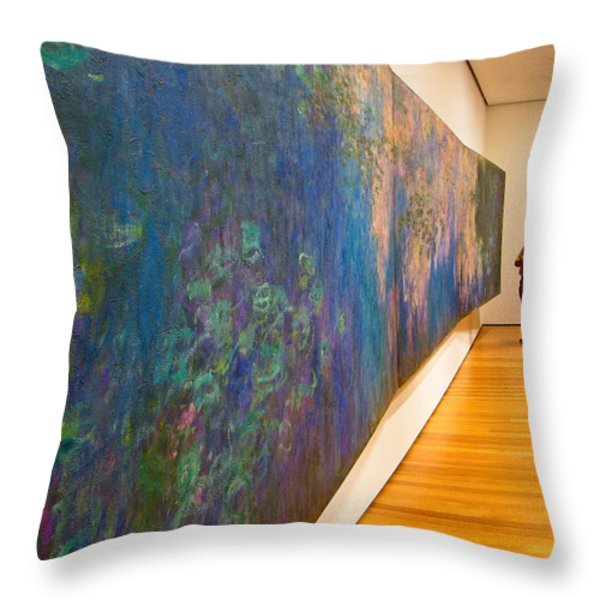 Man Studies Monet Painting Throw Pillow by Amy Cicconi