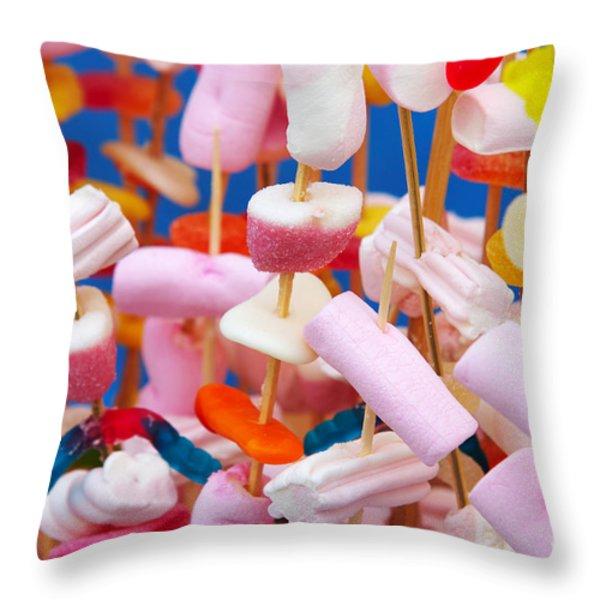 Marshmallow Throw Pillow by Carlos Caetano