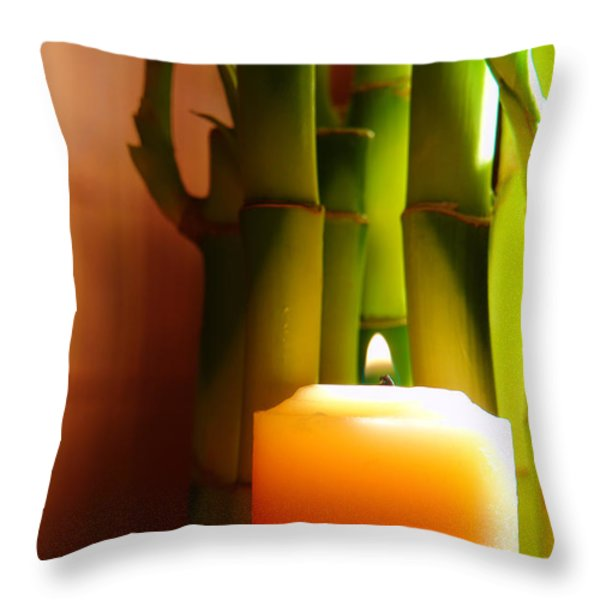 Meditation Candle and Bamboo Throw Pillow by Olivier Le Queinec