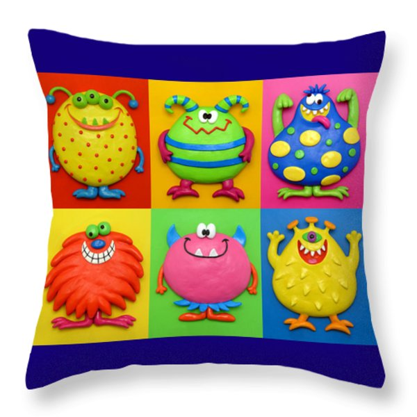 Monsters Throw Pillow by Amy Vangsgard