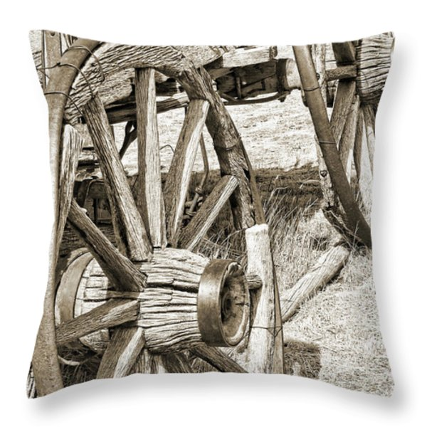 Montana Old Wagon Wheels in Sepia Throw Pillow by Jennie Marie Schell