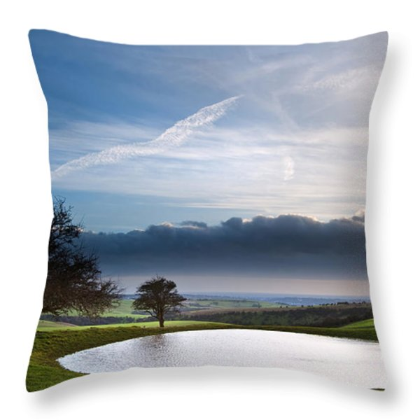 Naturally formed dew pond in countryside landscape with moody sk Throw Pillow by Matthew Gibson