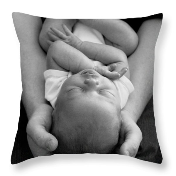 Newborn In Arms Throw Pillow by Lisa Phillips