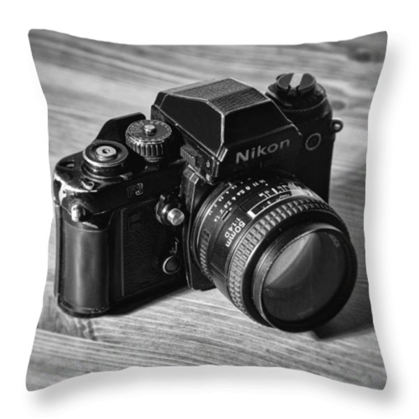 Nikon f3 Throw Pillow by Taylan Soyturk