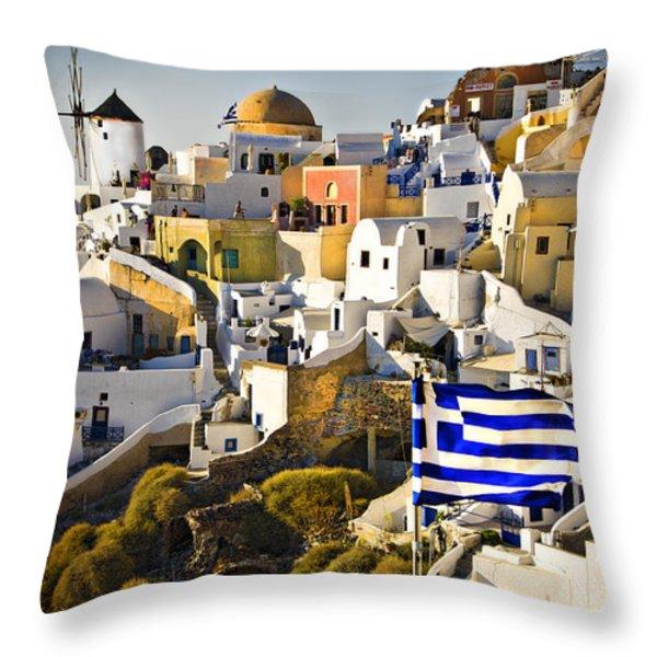Oia and a greek flag Throw Pillow by Meirion Matthias