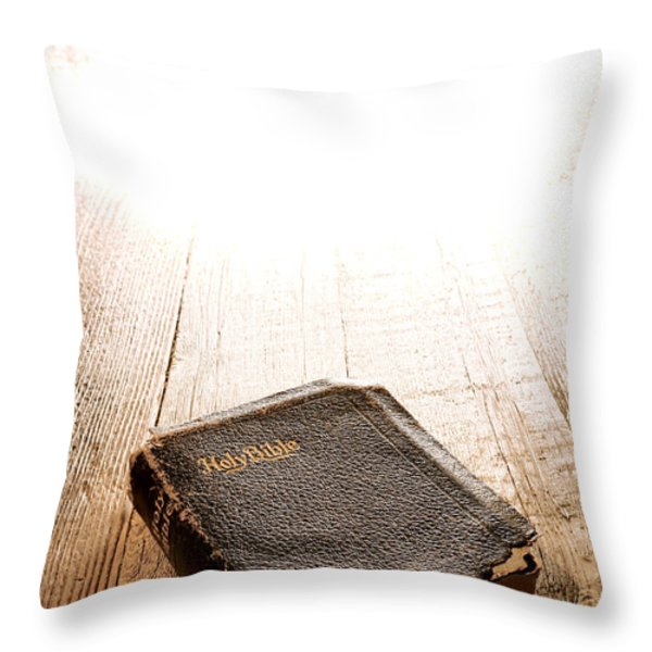 Old Bible in Divine Light Throw Pillow by Olivier Le Queinec