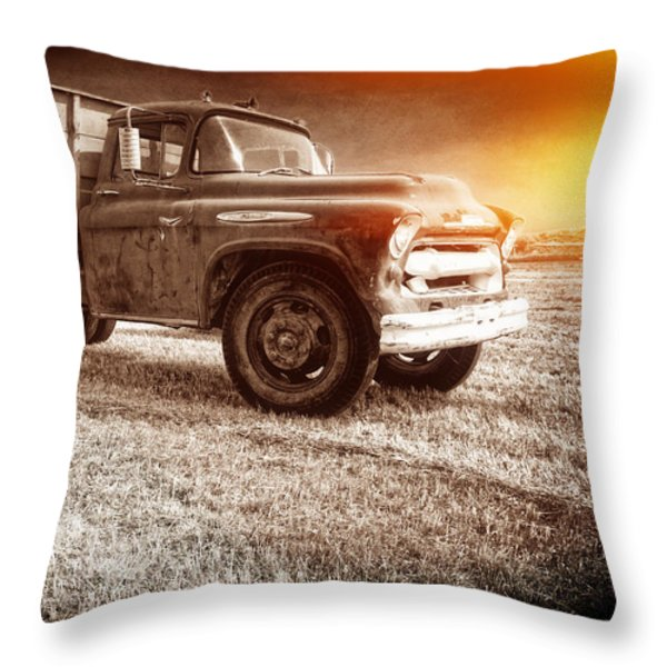 Old farm truck with explosion at night Throw Pillow by Edward Fielding