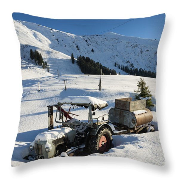 Old tractor in winter with lots of snow waiting for spring Throw Pillow by Matthias Hauser