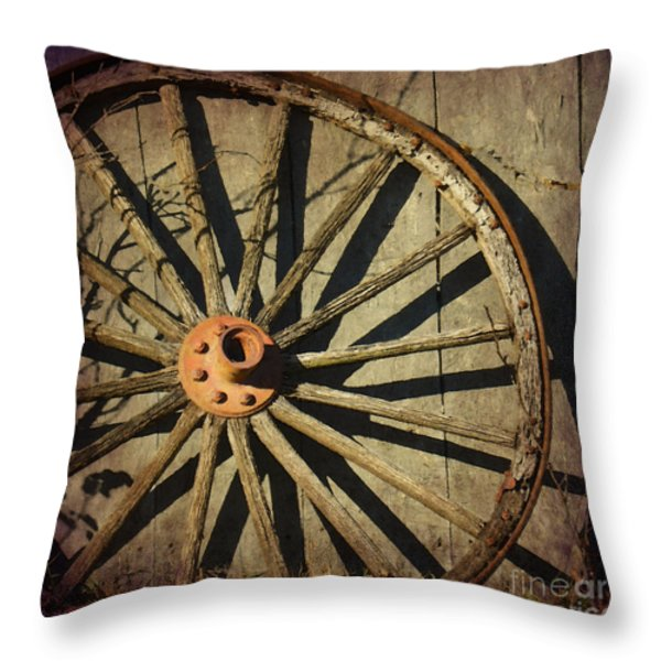 Old West Wagon Wheel Throw Pillow by Betty LaRue