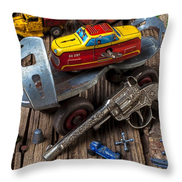 Older roller skate and toys Throw Pillow by Garry Gay
